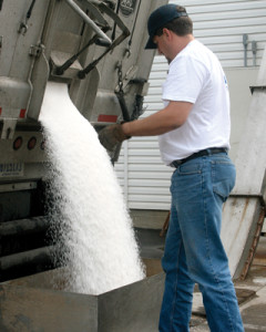 Employee unloading fertilizer, Wilbur-Ellis