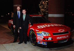 Rick Brandt. left, stands beside the company-sponsored NASCAR Chevrolet Impala, driven by Justin Allgaier.