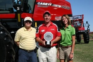 Mark Burns of Case IH poses with the 2012 CropLife Iron ShowStopper award in front of the winning product, the 4430 Patriot sprayer. Also, pictured are Iron editor Eric Sfiligoj and Jean Payne of the Illinois Fertilizer & Chemical Association.