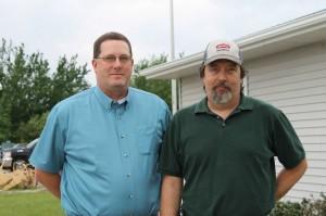 DuPont Representative Scott Bishop, left, and Wilbur-Ellis Edmore Plant Manager Brian Collins.