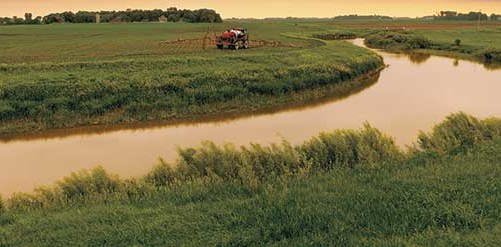 vintage_photo_river_through_farm_and_sprayer