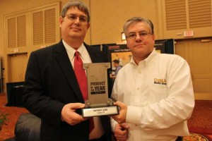 Case IH's Ken Lehmann, left, receives the 2013 Product of the Year award from CropLife Editor Eric Sfiligoj.