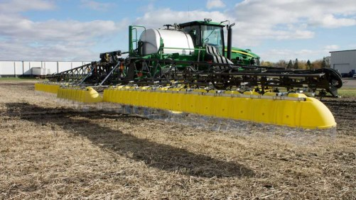 When compared to an open-boom sprayer, hoods allow for better time management, more timely application and increased sprayer value, says Willmar Fabrication.