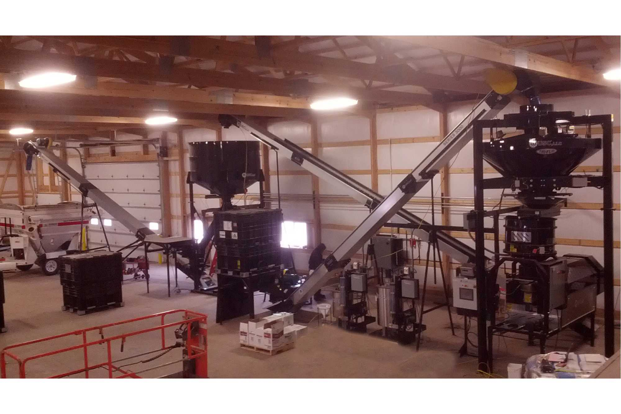 Gumz Seed Service's USC seed treating equipment. This versatile set-up allows the facility to pull seed in from outdoor bins as well as boxes for treating. The treated seed can be packaged in tenders, boxes, bags, or whatever the customer wants.