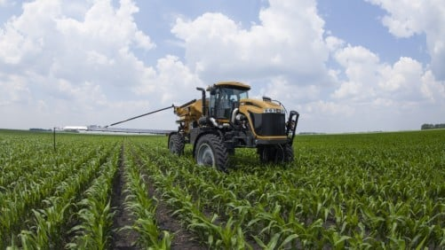The RoGator RG1300B self-propelled sprayer features a Tier 4 Final 8.4-liter AGCO Power engine and hydrostat drive package, providing superior power and reliability with greater fuel efficiency. It offers 90- to 120-foot booms with industry-leading tip-to-target control and consistent accuracy, advanced technology, adjustable track widths and an application cab designed to maximize operator comfort and safety. RG1300B optional features include direct chemical injection and the GatorTrak four-wheel steering system to minimize damage to crops and beds by leaving fewer tracks compared to conventional two-wheel steering systems. Operators can switch to high-volume/capacity dry fertilizer applications in less than a day's time.