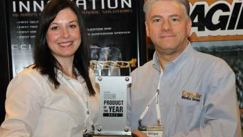 Amber Kohlhaas of Hagie Manufacturing accepts the 2014 CropLife IRON Product Of The Year Award from editor Eric Sfiligoj. Hagie won the award for its 2014 STS Series self-propelled sprayer.