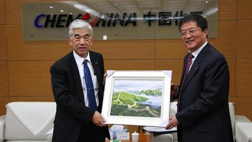 ChemChina General Manager Ren Jianxin (right). (Photo Credit - ChemChina.com.cn)
