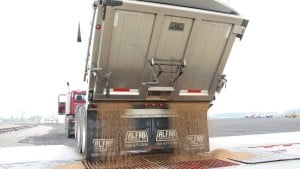 Truck dumping dry fertilizer