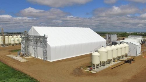 Greystone Construction built the tension membrane fertilizer storage building (left) and steel seed treater building (right)